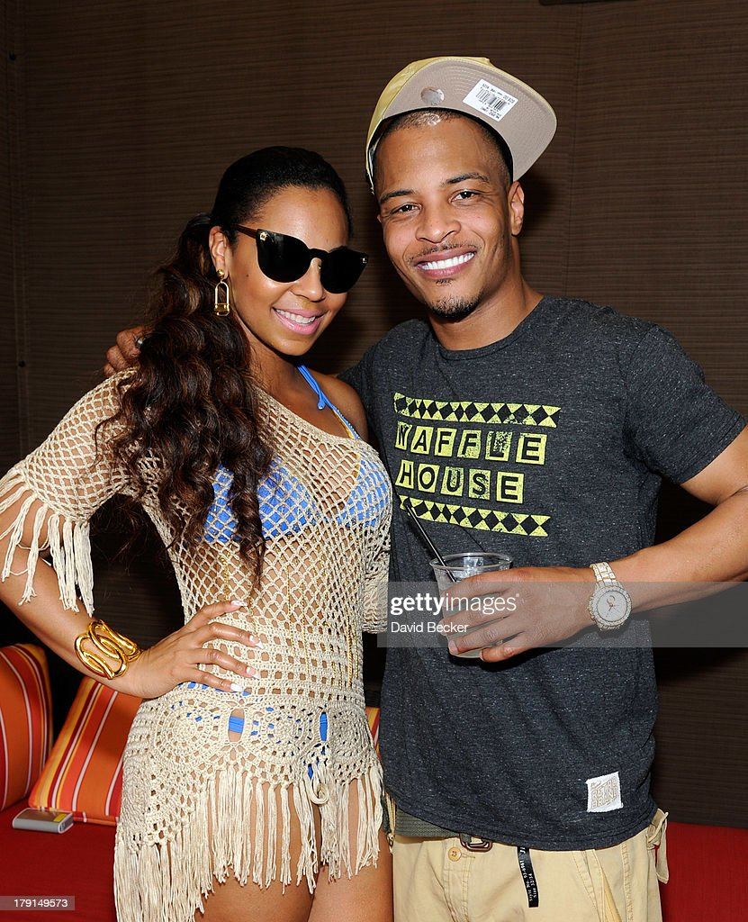 Singer/actress Ashanti (L) and rapper T.I. appear at 'Ditch Saturdays' at the Palms Pool & Bungalows at The Palms Casino Resort on August 31, 2013 in Las Vegas, Nevada.