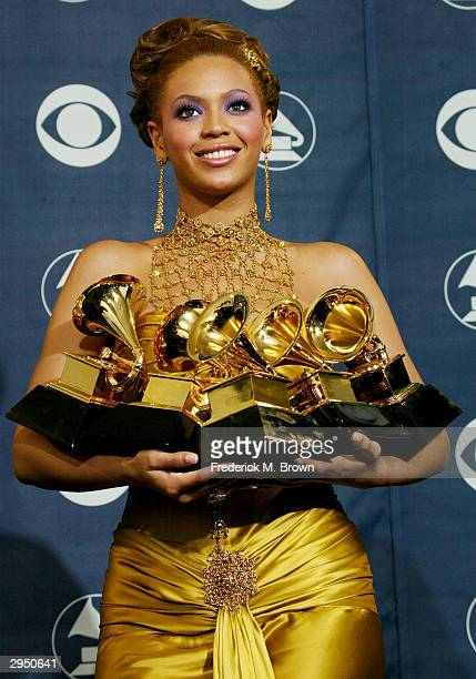 Singer/actress Beyonce Knowles poses backstage after winning 5 Grammy Awards in the Pressroom at the 46th Annual Grammy Awards held on February 8...