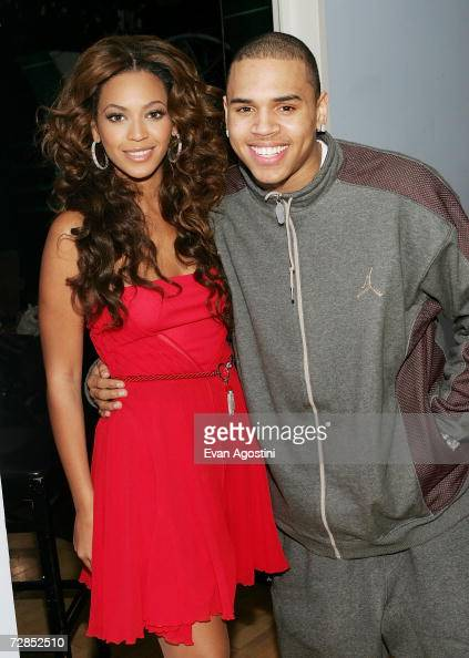 Singer/actress Beyonce Knowles poses with rapper Chris Brown backstage after an appearance on MTV's Total Request Live at MTV Studios December 19...