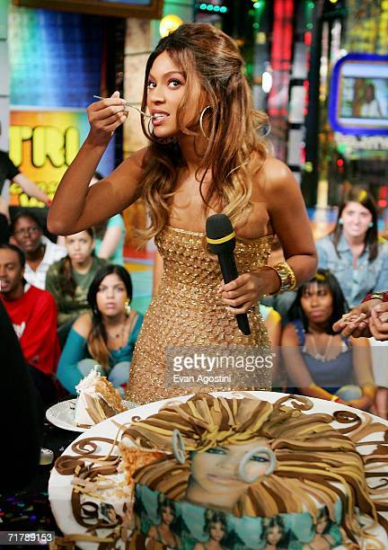 Singer/actress Beyonce Knowles receives a birthday cake in her likeness during her appearance on MTV's Total Request Live September 5 2006 in New...