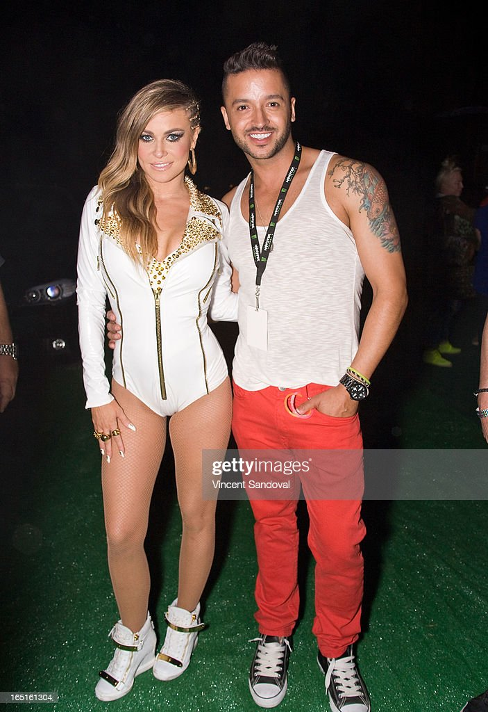 Singer/actress Carmen Electra and actor Jai Rodriguez attend the Circus Xtreme T-Dance during Jeffrey Sanker presents White Party Palm Springs 2013 Day 3 at the White Party Park on March 31, 2013 in Palm Springs, California.