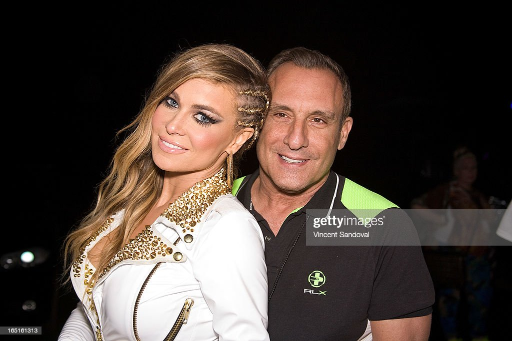 Singer/actress Carmen Electra and Jeffrey Sanker attend the Circus Xtreme T-Dance during Jeffrey Sanker presents White Party Palm Springs 2013 Day 3 at the White Party Park on March 31, 2013 in Palm Springs, California.
