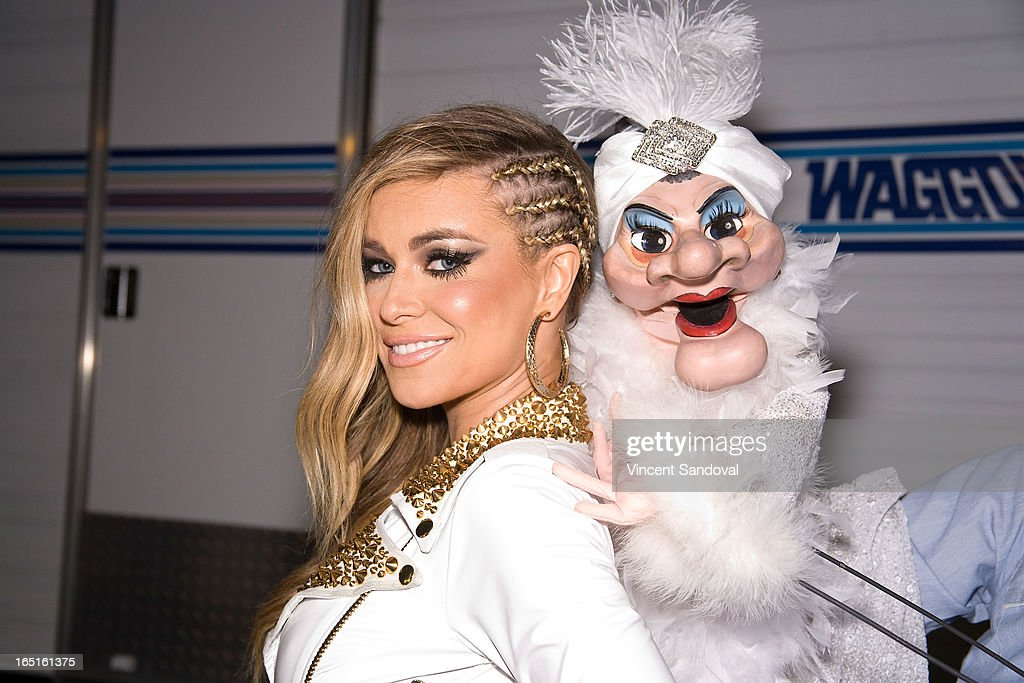 Singer/actress Carmen Electra and Madame attend the Circus Xtreme T-Dance during Jeffrey Sanker presents White Party Palm Springs 2013 Day 3 at the White Party Park on March 31, 2013 in Palm Springs, California.