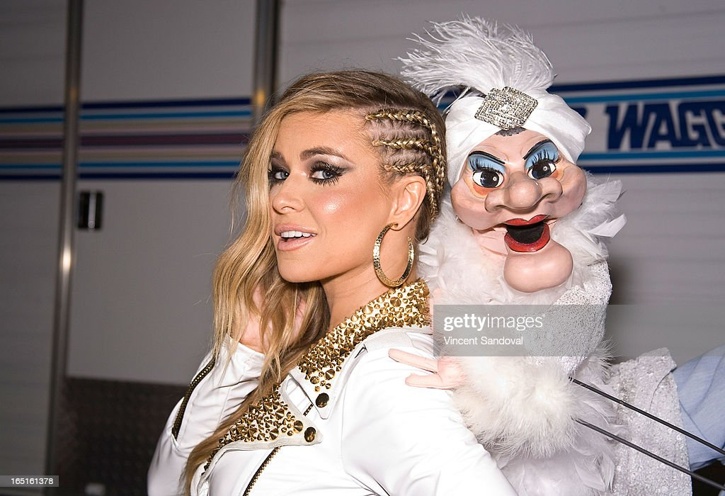 Singer/actress <a gi-track='captionPersonalityLinkClicked' href=/galleries/search?phrase=Carmen+Electra&family=editorial&specificpeople=171242 ng-click='$event.stopPropagation()'>Carmen Electra</a> and Madame attend the Circus Xtreme T-Dance during Jeffrey Sanker presents White Party Palm Springs 2013 Day 3 at the White Party Park on March 31, 2013 in Palm Springs, California.