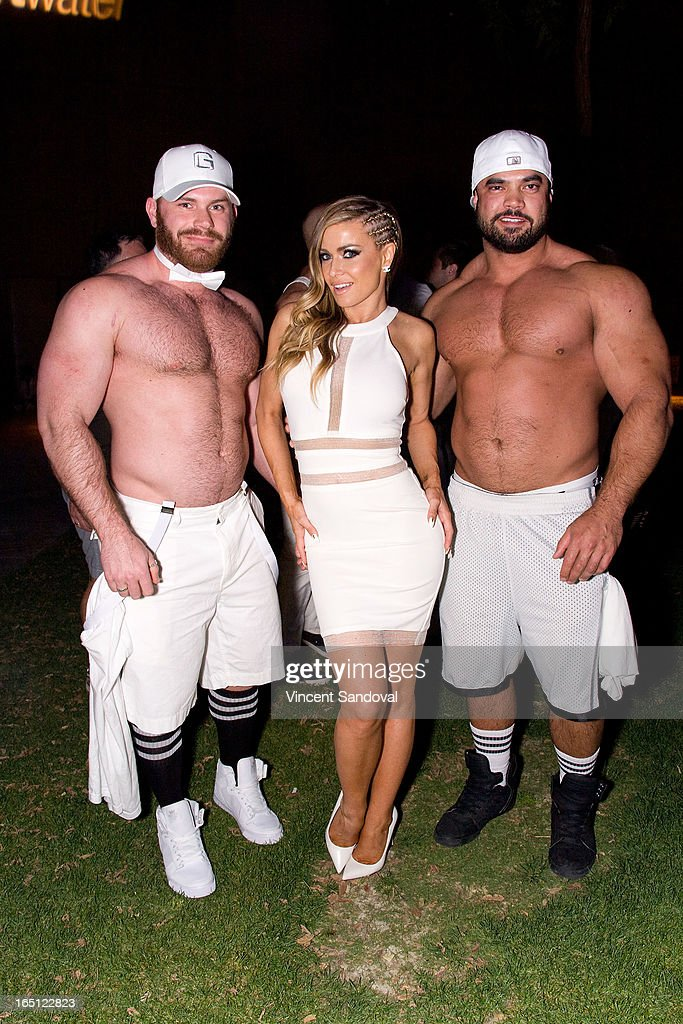 Singer/actress <a gi-track='captionPersonalityLinkClicked' href=/galleries/search?phrase=Carmen+Electra&family=editorial&specificpeople=171242 ng-click='$event.stopPropagation()'>Carmen Electra</a> (C) attends The White Party during Jeffrey Sanker Presents White Party Palm Springs 2013 - Day 2 at the Convention Center on March 30, 2013 in Palm Springs, California.