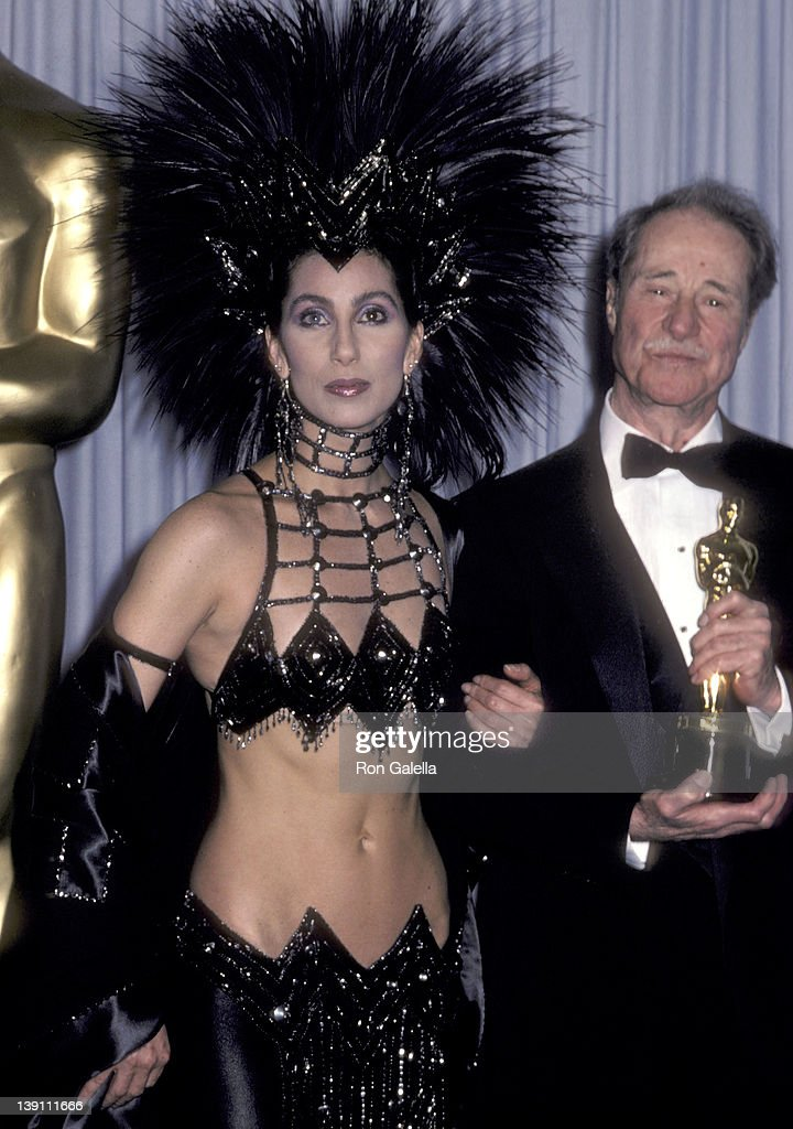 Singer/Actress Cher and actor <a gi-track='captionPersonalityLinkClicked' href=/galleries/search?phrase=Don+Ameche&family=editorial&specificpeople=214190 ng-click='$event.stopPropagation()'>Don Ameche</a> attend the 58th Annual Academy Awards on March 24, 1986 at Dorothy Chandler Pavilion, Los Angeles Music Center in Los Angeles, California.
