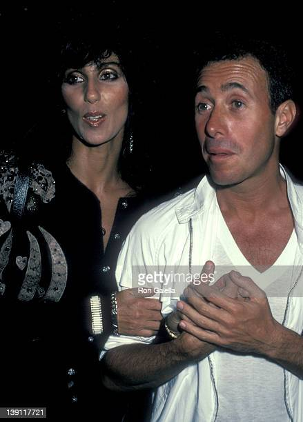 Singer/Actress Cher and producer David Geffen attend Eddie Murphy's Private Party on August 24 1983 at the Hard Rock Cafe in Los Angeles California