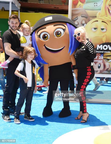 Singer/actress Christina Aguilera Matthew Rutler and family arrive at the Premiere Of Columbia Pictures And Sony Pictures Animation's 'The Emoji...