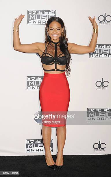 Singer/actress Christina Milian poses in the press room at the 2014 American Music Awards at Nokia Theatre LA Live on November 23 2014 in Los Angeles...