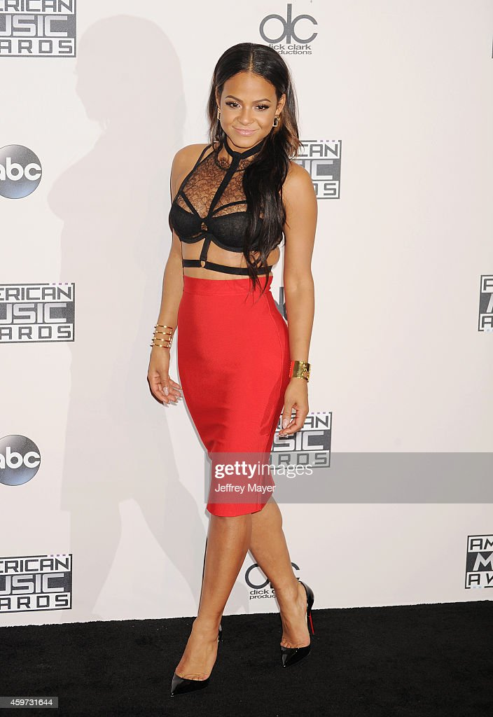 Singer/actress Christina Milian poses in the press room at the 2014 American Music Awards at Nokia Theatre L.A. Live on November 23, 2014 in Los Angeles, California.