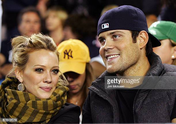 Singer/actress Hilary Duff and Mike Comrie of the New York Islanders attend the game between the New York Yankees and the Chicago White Sox on...