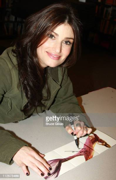 Singer/Actress Idina Menzel poses as she signs copies of her cd 'I Stand' for LIFEbeat's Valentines Day charity sale at Borders Columbus Circle on...