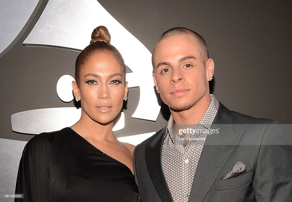 Singer/actress Jennifer Lopez (L) and dancer <a gi-track='captionPersonalityLinkClicked' href=/galleries/search?phrase=Casper+Smart&family=editorial&specificpeople=7596672 ng-click='$event.stopPropagation()'>Casper Smart</a> attend the 55th Annual GRAMMY Awards at STAPLES Center on February 10, 2013 in Los Angeles, California.