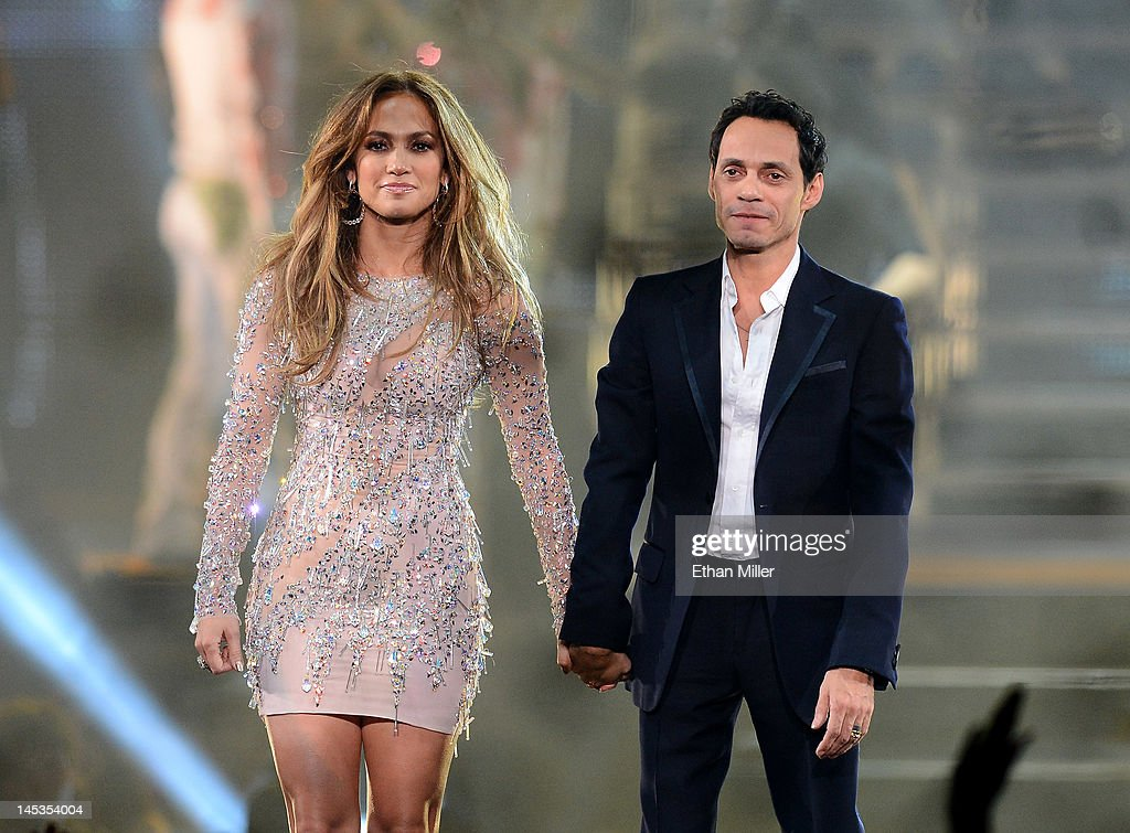 Singer/actress <a gi-track='captionPersonalityLinkClicked' href=/galleries/search?phrase=Jennifer+Lopez&family=editorial&specificpeople=201784 ng-click='$event.stopPropagation()'>Jennifer Lopez</a> (L) and singer <a gi-track='captionPersonalityLinkClicked' href=/galleries/search?phrase=Marc+Anthony&family=editorial&specificpeople=202544 ng-click='$event.stopPropagation()'>Marc Anthony</a> appear during the finale of the Q'Viva! The Chosen Live show at the Mandalay Bay Events Center on May 26, 2012 in Las Vegas, Nevada.