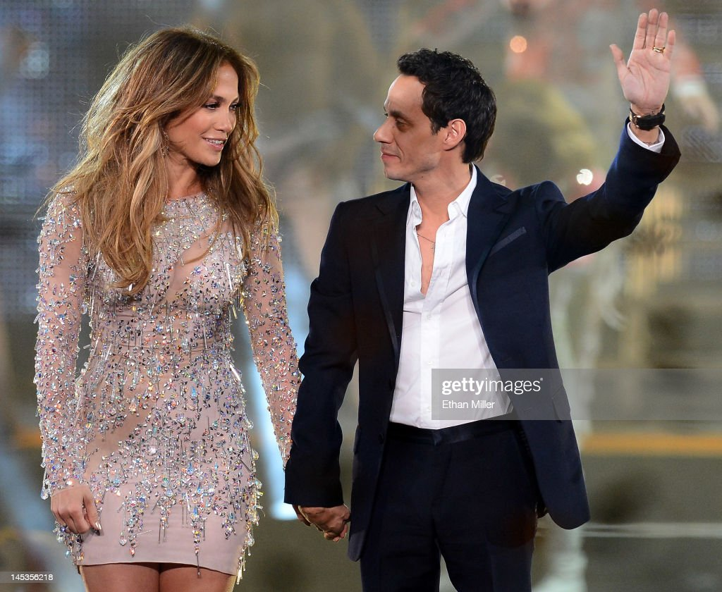 Singer/actress Jennifer Lopez and singer Marc Anthony appear during the finale of the Q'Viva The Chosen Live show at the Mandalay Bay Events Center...