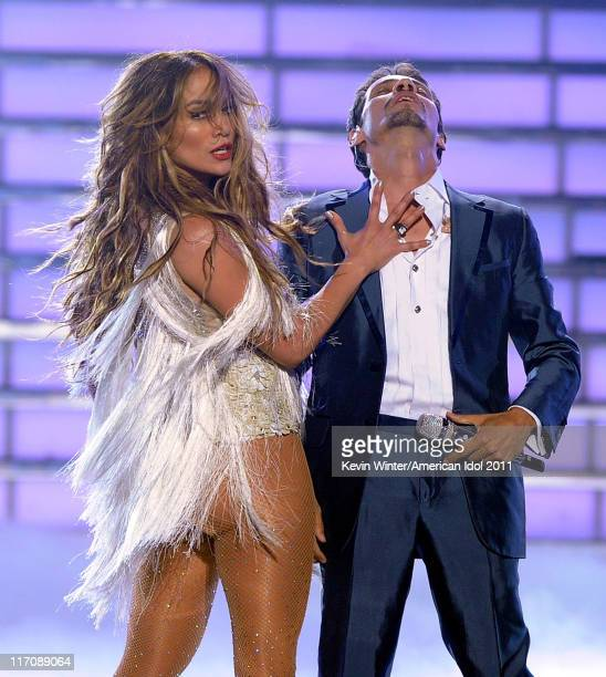 Singer/actress Jennifer Lopez and singer Marc Anthony perform onstage during Fox's 'American Idol 2011' finale results show held at Nokia Theatre LA...
