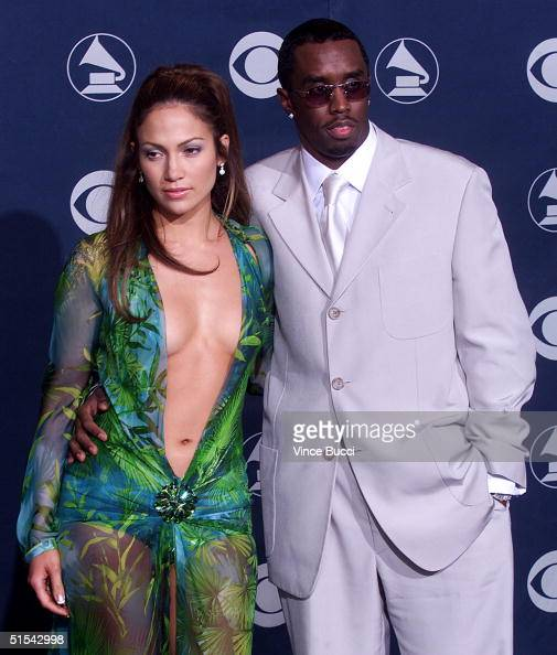 Singer/actress Jennifer Lopez poses with her boyfriend Sean 'Puffy' Combs for photographers at the 42nd Annual Grammy Awards at the Staples Center in...