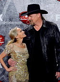 Singer/actress Kristin Chenoweth and singer Trace Adkins pose in the press room during the 2012 American Country Awards at the Mandalay Bay Events...