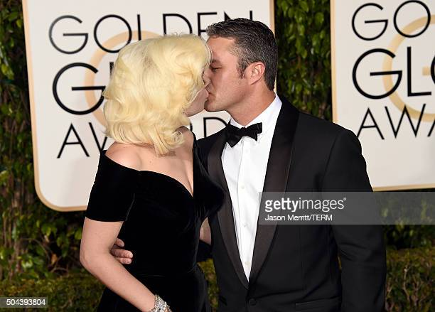 Singer/actress Lady Gaga and actor Taylor Kinney attend the 73rd Annual Golden Globe Awards held at the Beverly Hilton Hotel on January 10 2016 in...