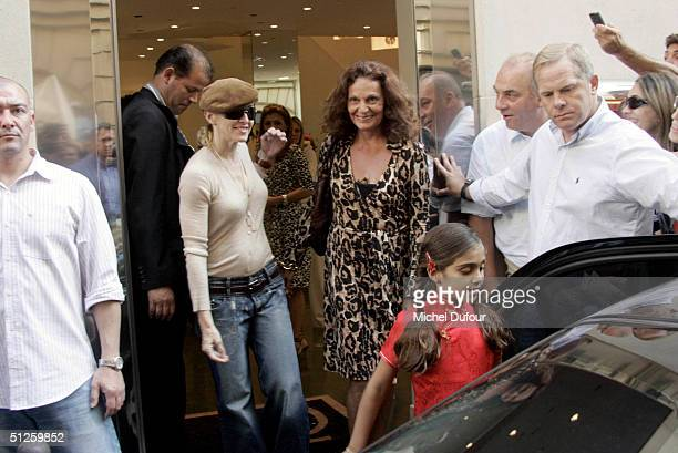 Singer/Actress Madonna leaves her hotel during a stay in Paris at the Four Seasons Hotel with her daughter Lourdes on September 3 2004 in Paris France
