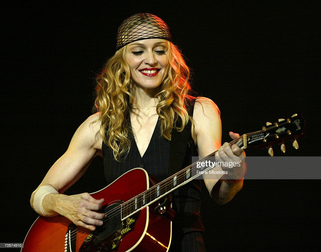 Singer/actress <a gi-track='captionPersonalityLinkClicked' href=/galleries/search?phrase=Madonna+-+S%C3%A5ngerska&family=editorial&specificpeople=156408 ng-click='$event.stopPropagation()'>Madonna</a> performs onstage during her 'Re-Invention' World Tour 2004 at The Great Western Forum, May 26, 2004 in Inglewood, California. The outfit she is wearing is designed by Christian LaCroix.