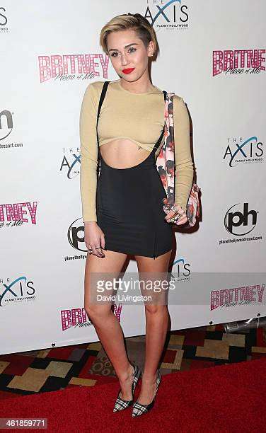 Singer/actress Miley Cyrus arrives at the grand opening of Britney Spears' twoyear residency 'Britney Piece of Me' at Planet Hollywood Resort Casino...