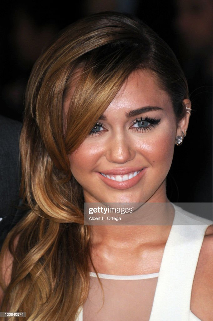Singer/actress <a gi-track='captionPersonalityLinkClicked' href=/galleries/search?phrase=Miley+Cyrus&family=editorial&specificpeople=3973523 ng-click='$event.stopPropagation()'>Miley Cyrus</a> arrives for the 2012 People's Choice Awards held at Nokia Theatre L.A. Live on January 11, 2012 in Los Angeles, California.