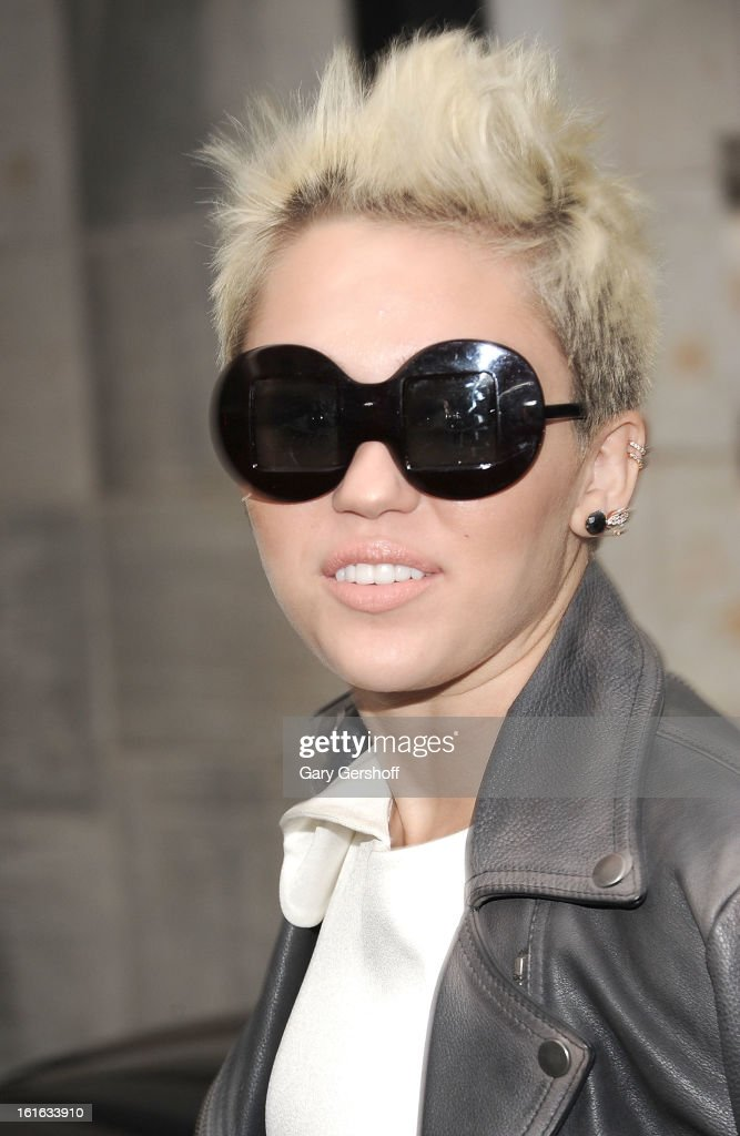 Singer/actress <a gi-track='captionPersonalityLinkClicked' href=/galleries/search?phrase=Miley+Cyrus&family=editorial&specificpeople=3973523 ng-click='$event.stopPropagation()'>Miley Cyrus</a> attends Marchesa during Fall 2013 Mercedes-Benz Fashion Week at New York Public Library - Celeste Bartos on February 13, 2013 in New York City.