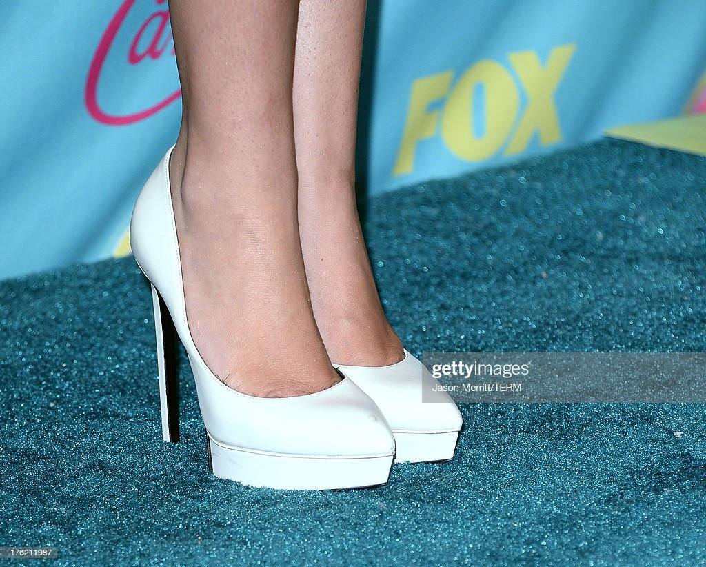 Singer/Actress Miley Cyrus (shoes details) attends the Teen Choice Awards 2013 at Gibson Amphitheatre on August 11, 2013 in Universal City, California.