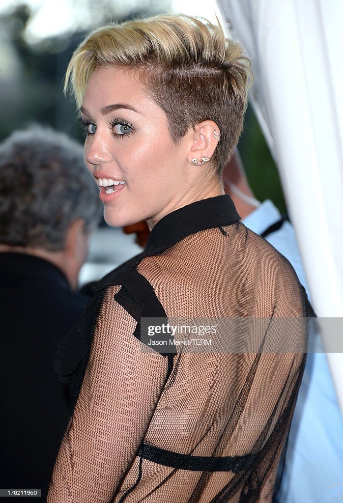 Singer/Actress Miley Cyrus, winner of Choice Summer Song for 'We Can't Stop', Choice Female TV Scene Stealer for 'The Big Bang Theory' , and Candie's Fashion Trendsetter Award attends the Teen Choice Awards 2013 at Gibson Amphitheatre on August 11, 2013 in Universal City, California.
