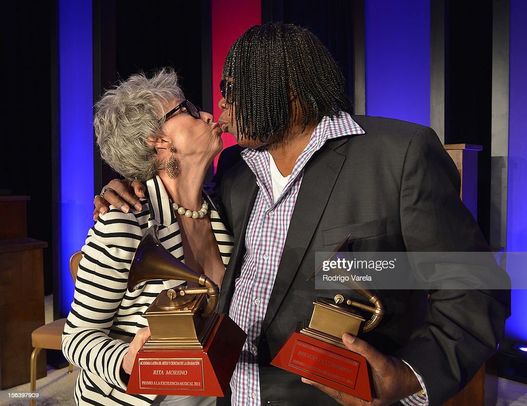 Singer/actress Rita Moreno (L) and singer/songwriter Milton Nascimento kiss as they attend the 2012 Latin Recording Academy Special Awards during the 13th annual Latin GRAMMY Awards at the Four Seasons Hotel on November 14, 2012 in Las Vegas, Nevada.