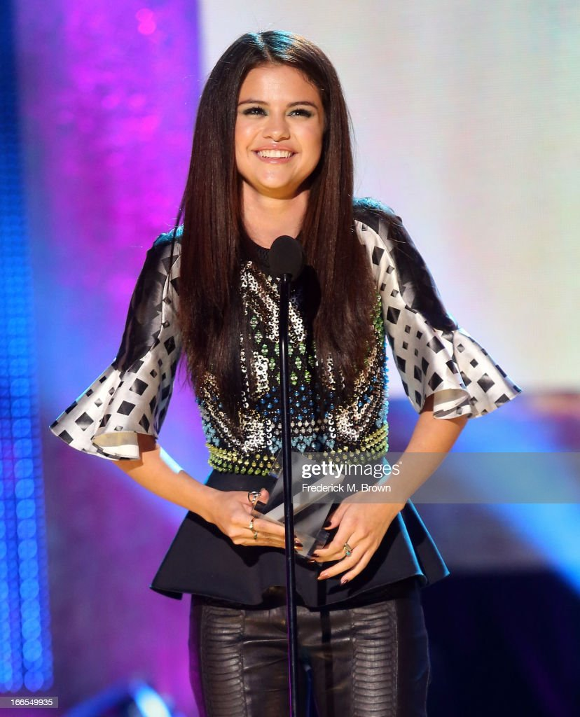 Singer/actress <a gi-track='captionPersonalityLinkClicked' href=/galleries/search?phrase=Selena+Gomez&family=editorial&specificpeople=4295969 ng-click='$event.stopPropagation()'>Selena Gomez</a> accepts the Triple Play Award onstage during the 2013 NewNowNext Awards at The Fonda Theatre on April 13, 2013 in Los Angeles, California.