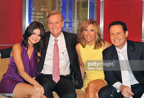 Singer/actress Selena Gomez and FOX Friends hosts Steve Doocy Alisyn Camerota and Brian Kilmeade pose for photo at 'FOX Friends' at FOX Studios on...