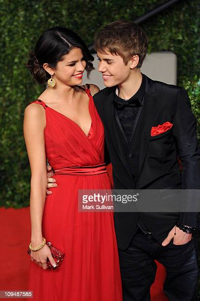 Singeractress Selena Gomez and singer Justin Bieber arrive at the Vanity Fair Oscar party hosted by Graydon Carter held at Sunset Tower on February...