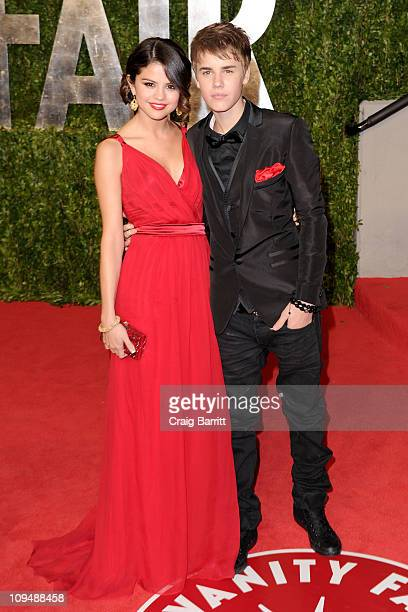 Singer/actress Selena Gomez and singerJustin Bieber arrive at the Vanity Fair Oscar party hosted by Graydon Carter held at Sunset Tower on February...