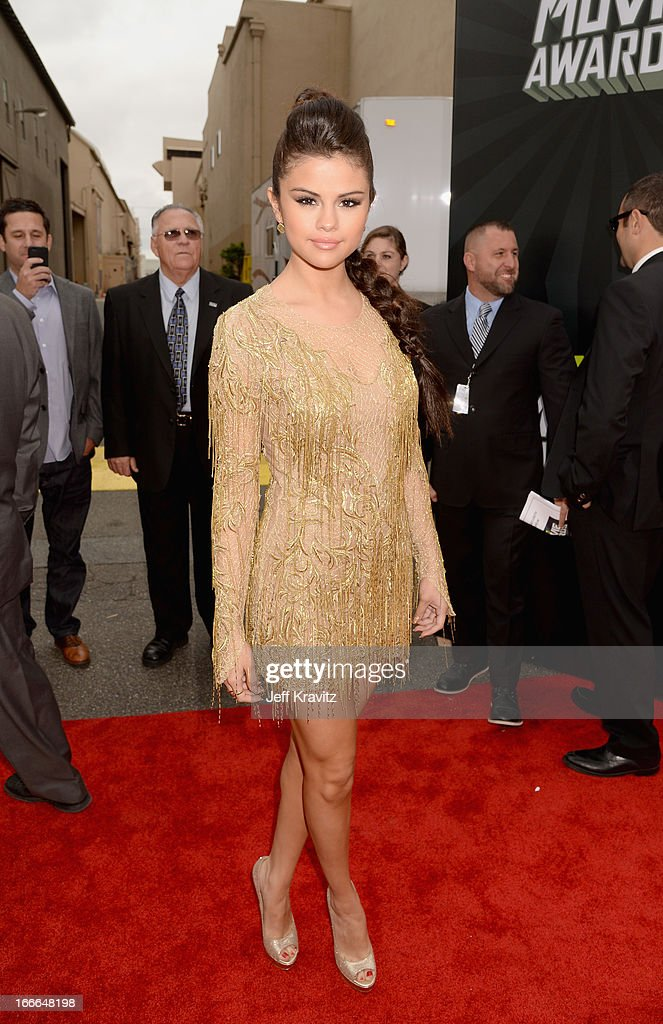 Singer/actress <a gi-track='captionPersonalityLinkClicked' href=/galleries/search?phrase=Selena+Gomez&family=editorial&specificpeople=4295969 ng-click='$event.stopPropagation()'>Selena Gomez</a> attends the 2013 MTV Movie Awards at Sony Pictures Studios on April 14, 2013 in Culver City, California.