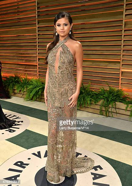 Singer/actress Selena Gomez attends the 2014 Vanity Fair Oscar Party Hosted By Graydon Carter on March 2 2014 in West Hollywood California