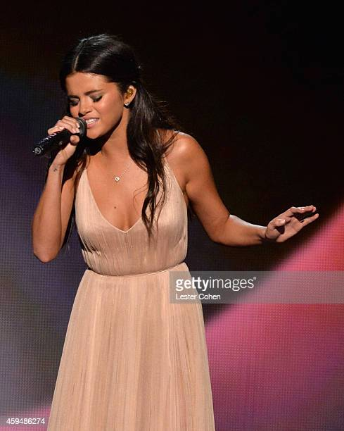 Singer/actress Selena Gomez performs onstage at the 2014 American Music Awards at Nokia Theatre LA Live on November 23 2014 in Los Angeles California