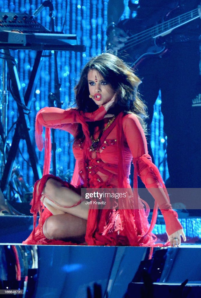 Singer/actress <a gi-track='captionPersonalityLinkClicked' href=/galleries/search?phrase=Selena+Gomez&family=editorial&specificpeople=4295969 ng-click='$event.stopPropagation()'>Selena Gomez</a> performs onstage during the 2013 MTV Movie Awards at Sony Pictures Studios on April 14, 2013 in Culver City, California.