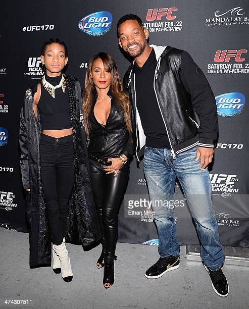 Singer/actress Willow Smith actress/producer Jada Pinkett Smith and actor Will Smith attend the UFC 170 event at the Mandalay Bay Events Center on...