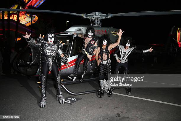 Singer/bassist Gene Simmons drummer Eric Singer singer/guitarist Paul Stanley and guitarist Tommy Thayer of Kiss pose after arriving by helicopter at...