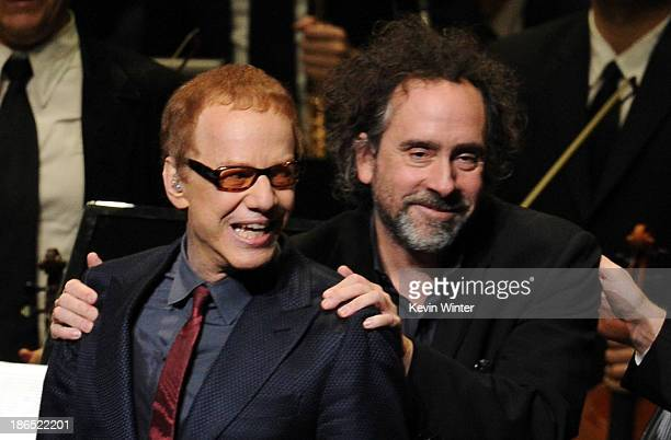 Singer/composer Danny Elfman and director Tim Burton speak onstage during Danny Elfman's Music from the films of Tim Burton at Nokia Theatre LA Live...