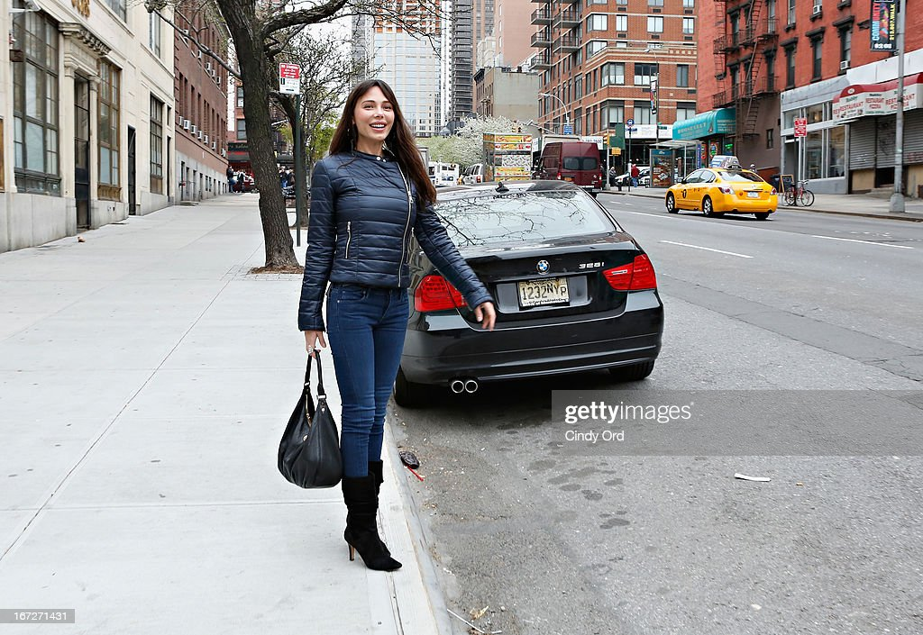 Singer/composer Oksana Grigorieva hails a cab after visiting CBS's 'The Couch' at CBS Studios on April 23, 2013 in New York City.