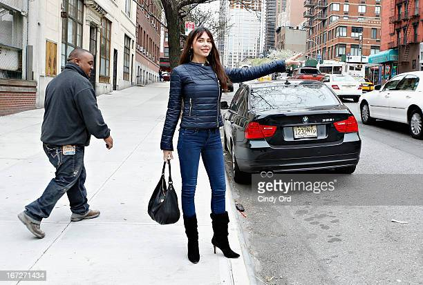 Singer/composer Oksana Grigorieva hails a cab after visiting CBS's 'The Couch' at CBS Studios on April 23 2013 in New York City