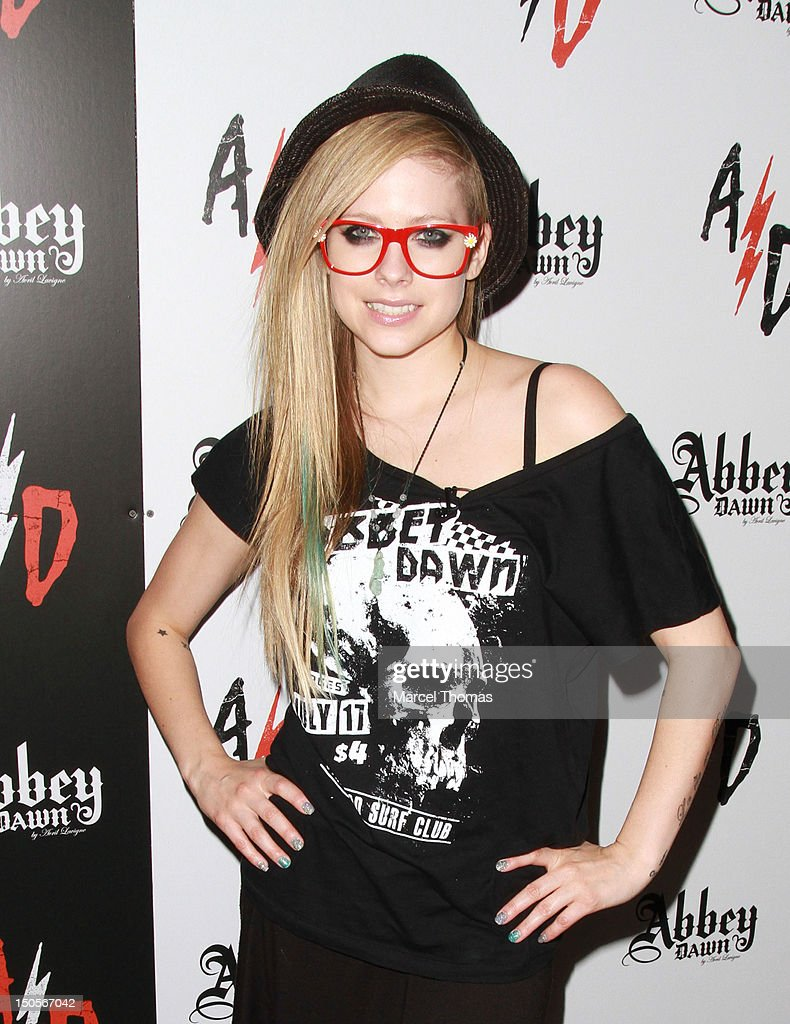Singer/designer <a gi-track='captionPersonalityLinkClicked' href=/galleries/search?phrase=Avril+Lavigne&family=editorial&specificpeople=171190 ng-click='$event.stopPropagation()'>Avril Lavigne</a> visits her Abbey Dawn booth at the 2012 MAGIC Convention at Las Vegas Convention Center on August 21, 2012 in Las Vegas, Nevada.