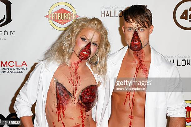 Singer/drag entertainer Courtney Act and TV personality Simon SherryWood attend Fred Jason's Annual Halloweenie Celebrity Charity Event on October 26...