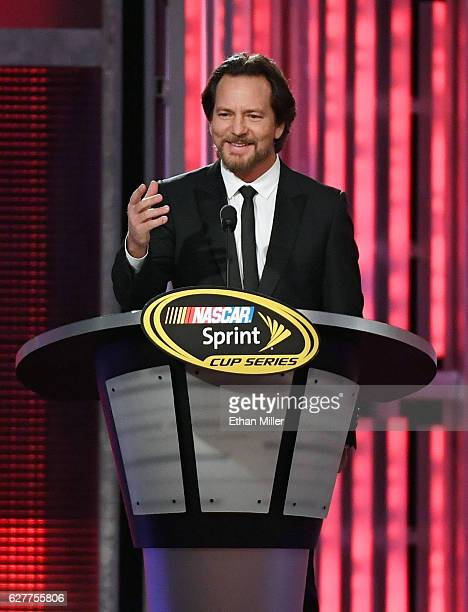 Singer/guitarist Eddie Vedder of Pearl Jam introduces NASCAR Sprint Cup Series driver Tony Stewart during the 2016 NASCAR Sprint Cup Series Awards...