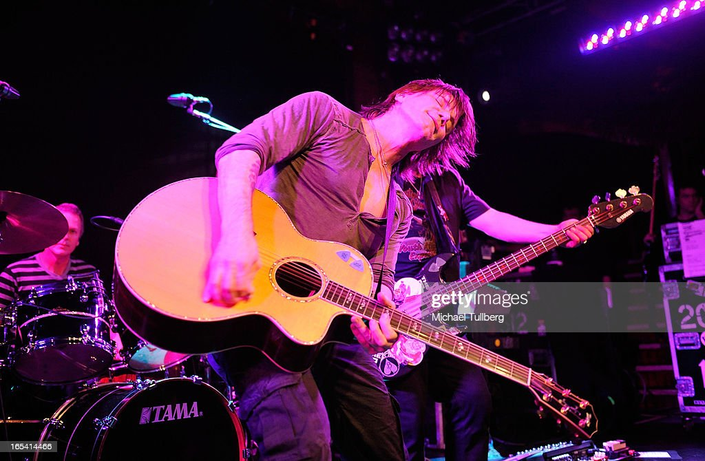 Singer/guitarist <a gi-track='captionPersonalityLinkClicked' href=/galleries/search?phrase=John+Rzeznik&family=editorial&specificpeople=220876 ng-click='$event.stopPropagation()'>John Rzeznik</a> and bassist <a gi-track='captionPersonalityLinkClicked' href=/galleries/search?phrase=Robby+Takac&family=editorial&specificpeople=778886 ng-click='$event.stopPropagation()'>Robby Takac</a> of the Goo Goo Dolls perform live at Troubadour on April 3, 2013 in West Hollywood, California.