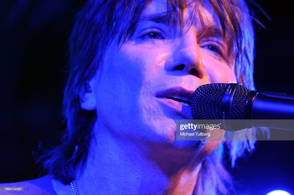 Singer/guitarist <a gi-track='captionPersonalityLinkClicked' href=/galleries/search?phrase=John+Rzeznik&family=editorial&specificpeople=220876 ng-click='$event.stopPropagation()'>John Rzeznik</a> of the Goo Goo Dolls performs live at Troubadour on April 3, 2013 in West Hollywood, California.
