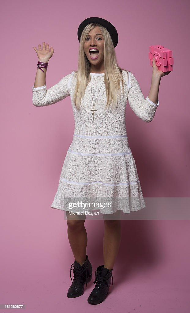 Singer/Guitarist Laura Wilde poses for portraits at the Mark Kearney Group - 'Iced Out' Luxury Emmy Suite on September 19, 2013 in Los Angeles, California.